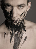 Dramatic fashion art portrait of man in black paint Royalty Free Stock Photo