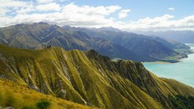 Dramatic features of Southern Alps with blue lake in the background, New Zealand stock photography