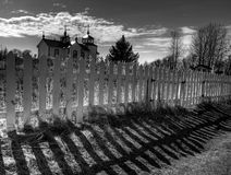 Dramatic fence shadow with Russian church Stock Photo