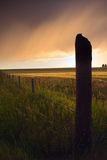 Dramatic Fenceline. A farmland fenceline shot during a summer thunderstorm stock images