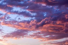Dramatic fiery sunset sky. In a mixture of violet, pink, orange and black colors Royalty Free Stock Image