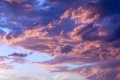 Dramatic fiery sunset sky. In a mixture of violet, pink, orange and black colors Stock Images