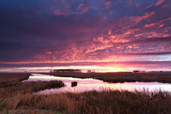 Dramatic fire sunrise over river Royalty Free Stock Images