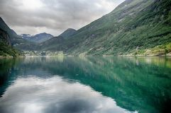 Dramatic fjord landscape in Norway. Travel in Norway fjord nature near mountain and water Stock Image