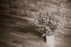 Dramatic flowers dried home decoration vintage. Dramatic flowers dried in vase on wood table vintage tone stock image