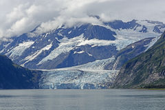 Dramatic Glacier Coming out of the Mountains Royalty Free Stock Photography