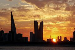 Dramatic golden clouds and Bahrain highrise buildings Stock Photography