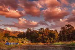 Dramatic golden hour at the river-side camping area. In Pai, Mae Hong Son province, the northern part of Thailand Stock Photos
