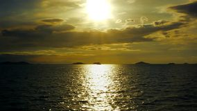 Dramatic golden sunset sky and tropical sea. Panoramic golden dramatic sunset sky and tropical sea stock footage