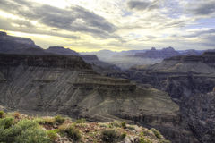 Dramatic Grand Canyon Light. Dramatic light falls across the massive expansive of the Grand Canyon from Horseshoe Mesa on the South Rim Stock Images