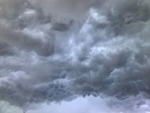 Grey sky before storm and raining. Dramatic grey sky before storm and raining royalty free stock images