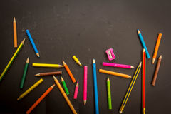 Dramatic group of pencils on black or dark background. Stock Images