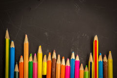 Dramatic group of pencils on black or dark background. Royalty Free Stock Photography