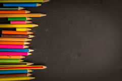 Dramatic group of pencils on black or dark background. Royalty Free Stock Photo