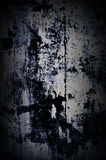 Dramatic grunge dark old painted wall with white and black splashes Royalty Free Stock Photo