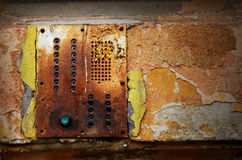 Dramatic grunge old wall with intercom panel buttons, background Royalty Free Stock Photos