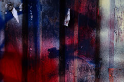 Dramatic grunge painted dark blue and red rusty garage door, bakground Royalty Free Stock Image