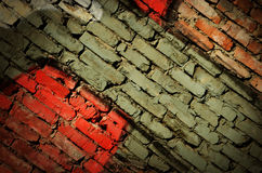 Dramatic grunge painted old wall with diagonal bricks,background Royalty Free Stock Photo