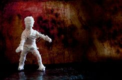 Dramatic Halloween background scary mummy character on vintage wall. Copy space Stock Photos