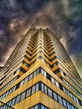Dramatic HDR-photo of building and clouds stock photos