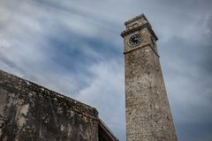 Dramatic heavy sky with old time tower in Sri Lanka, Galle fort stock photo