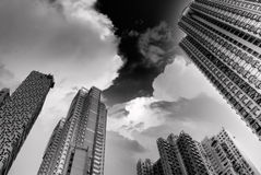 Dramatic high buildings touch sky Royalty Free Stock Photos