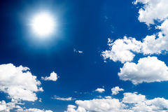 Dramatic high contrast blue sky with sun.  royalty free stock photo