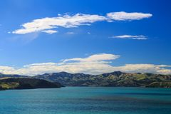 The hills and mountains of Banks Peninsula, New Zealand, from Akaroa Harbour royalty free stock image