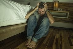 Free Dramatic Home Portrait Of Young Desperate And Depressed Lonely Man Sitting On Bedroom Floor Crying Sick Suffering Anxiety Crisis Royalty Free Stock Photo - 154930365