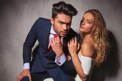 Dramatic hot elegant couple sitting embraced Stock Photos