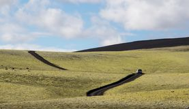Dramatic iceland landscape with a green hill and empty road stock photos