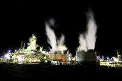 Dramatic image of industrial plant at night Stock Images