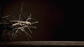 Dramatic Image Of Crown Of Thorns Against Dark Red Background As Symbol Of Death And Resurrection Of Jesus Christ Stock Photo