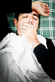 Dramatic image of a sick man in bed and coughing Royalty Free Stock Photography