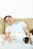Dramatic image of sick man laying in bed with fever Royalty Free Stock Images