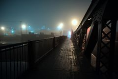 Dramatic industrial vintage river bridge scenery at night. Royalty Free Stock Images
