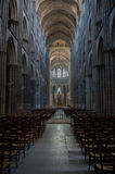 Dramatic interior of cathedral with rows of chairs Royalty Free Stock Photos