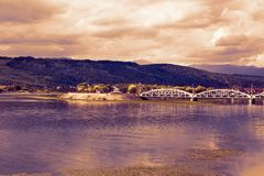 Dramatic landcape of the Jiu River on a cloudy day Stock Photo
