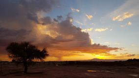 Sunset lights in the arid and desolate landscape of the Atacama Desert. Dramatic landscape of the Atacama desert at sunset with colored clouds, Atacama Desert royalty free stock photography