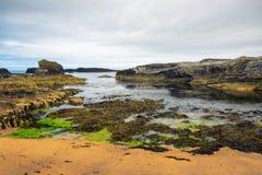 Dramatic landscape of the Ballintoy Harbor shoreline in Northern Ireland. Dramatic landscape of the Ballintoy Harbor shoreline located at the Northern coast of royalty free stock images