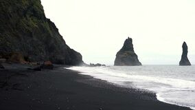 Dramatic landscape of Black Sand Reynisfjara beach in Iceland