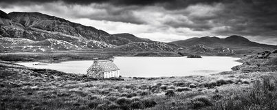 Dramatic landscape on Isle of Mull, Scotland. Dramatic landscape with old stone house at a lake on Isle of Mull, Scotland royalty free stock photography