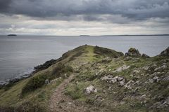 Moody landscape looking out to sea from headland during Autumn s Royalty Free Stock Images