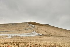 Dramatic landscape of muddy volcanoes river in Romania Royalty Free Stock Photography