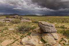 Dramatic landscape with rain clouds over the valley Stock Photo