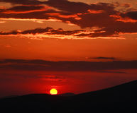 Dramatic landscape, red sunset on the sky Royalty Free Stock Photography