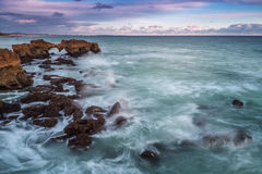 Dramatic landscape on the rocks on the beach in Albufeira. Stock Photos