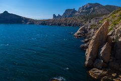 Dramatic landscape of rocky coastline and turquois water and blue sky. Crimea, Ukraine stock image