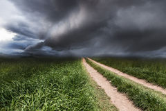 Dramatic landscape with a rural road Stock Photos