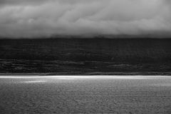 Dramatic landscape sunlight on lake clouds covering the mountain. Rules of third beautiful applies as I say myself black and white photography royalty free stock photography